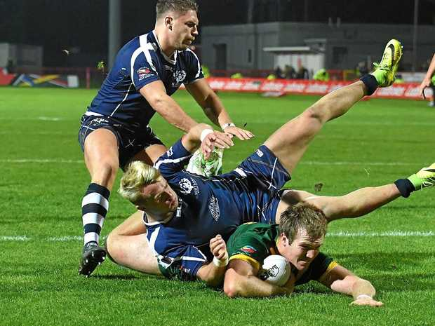 Australia's Jake Trbojevic scores the final try of the game during the Four Nations rugby league match against Scotland.