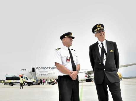 First officer Craig Freier (left) and Captain Peter Campbell prepare for the first international passenger flight by Qantas from Brisbane West Wellcamp Airport to Shanghai.