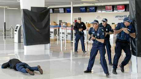 Police conduct an airport-based counter terrorism training exercise.