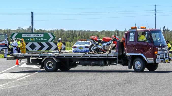 The bike involved in a fatal collision with a truck on the Ferry park turnoff on the Pacific Highway near Maclean is taken away.