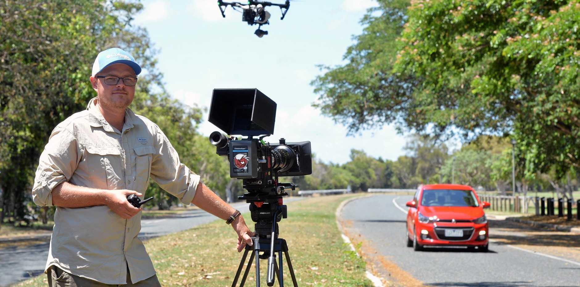 Director of photography Will Walquist films cars for Holden Australia on Binnington Esplanade in East Mackay.
