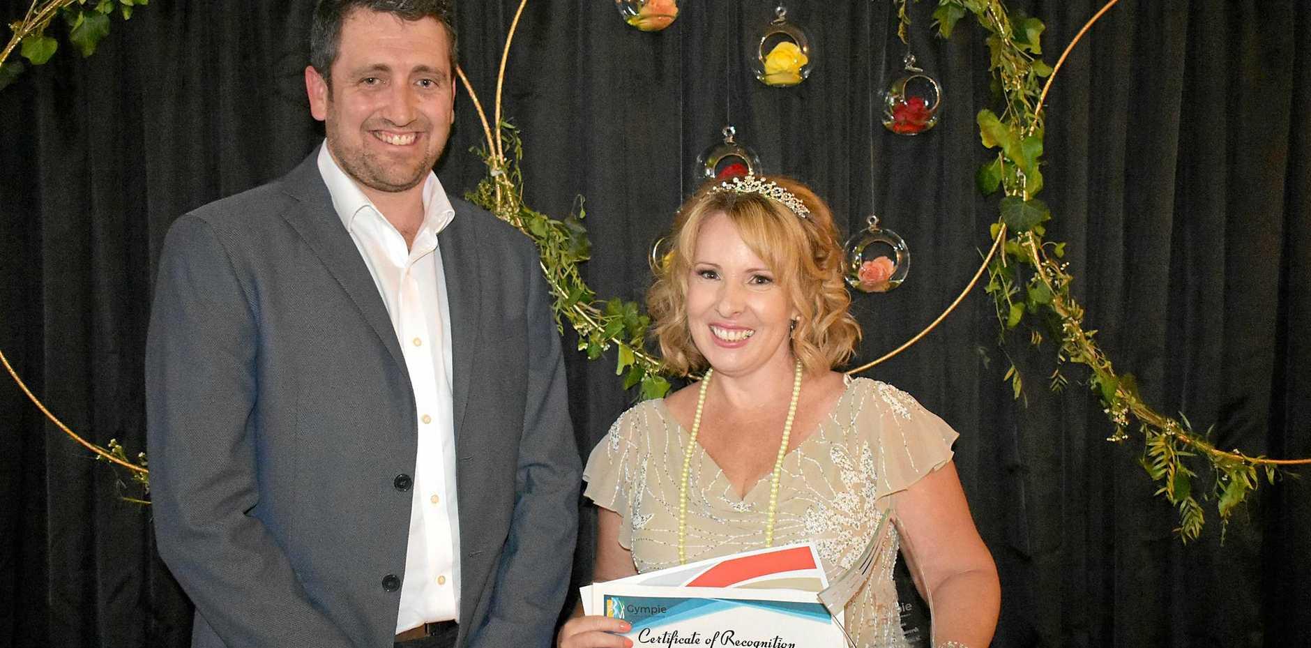 WIN: Adam Madill presents Jada Burns with her prize.