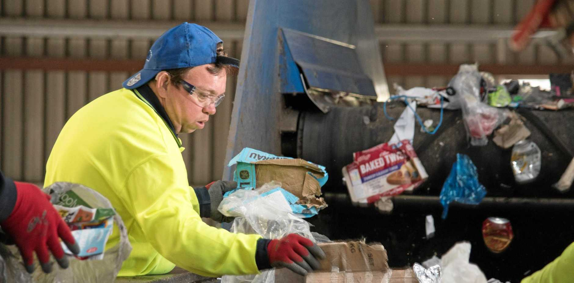 Sorting rubbish from recycling is a job undertaken by 25 disability workers at Anuha's Gatton Depot.