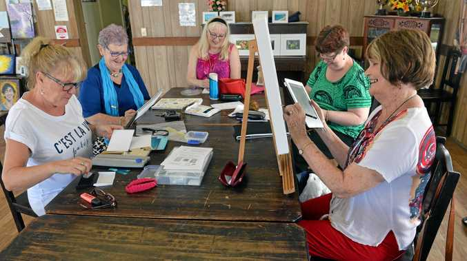 ARTISTS: Marilyn Gouttman, Heather Sprott, Tessa King, Christine Kenny and Anne Usher getting ready the Green Frogs' Art exhibit.