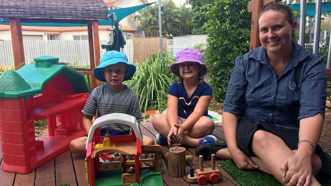Goodstart Mackay  Shakespeare Street Centre director Amanda Tomlinson with kindergarten children Beau Dubekaar and Indy Hortz.