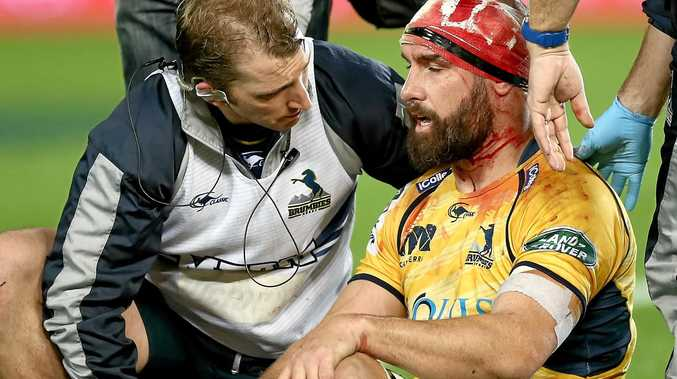 Scott Fardy of the Brumbies receives medical attention for a head injury during a Super Rugby match this year.