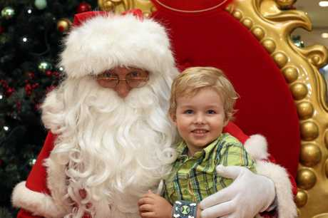 Nambour's Thomas Kelly lets Santa know what he wants for Christmas at Nambour Plaza. Photo: Jason Dougherty