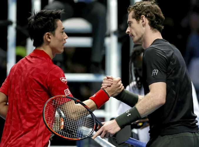 Britain's Andy Murray (right) shakes hands with Kei Nishikori of Japan after winning their ATP World Tour Finals singles tennis match.