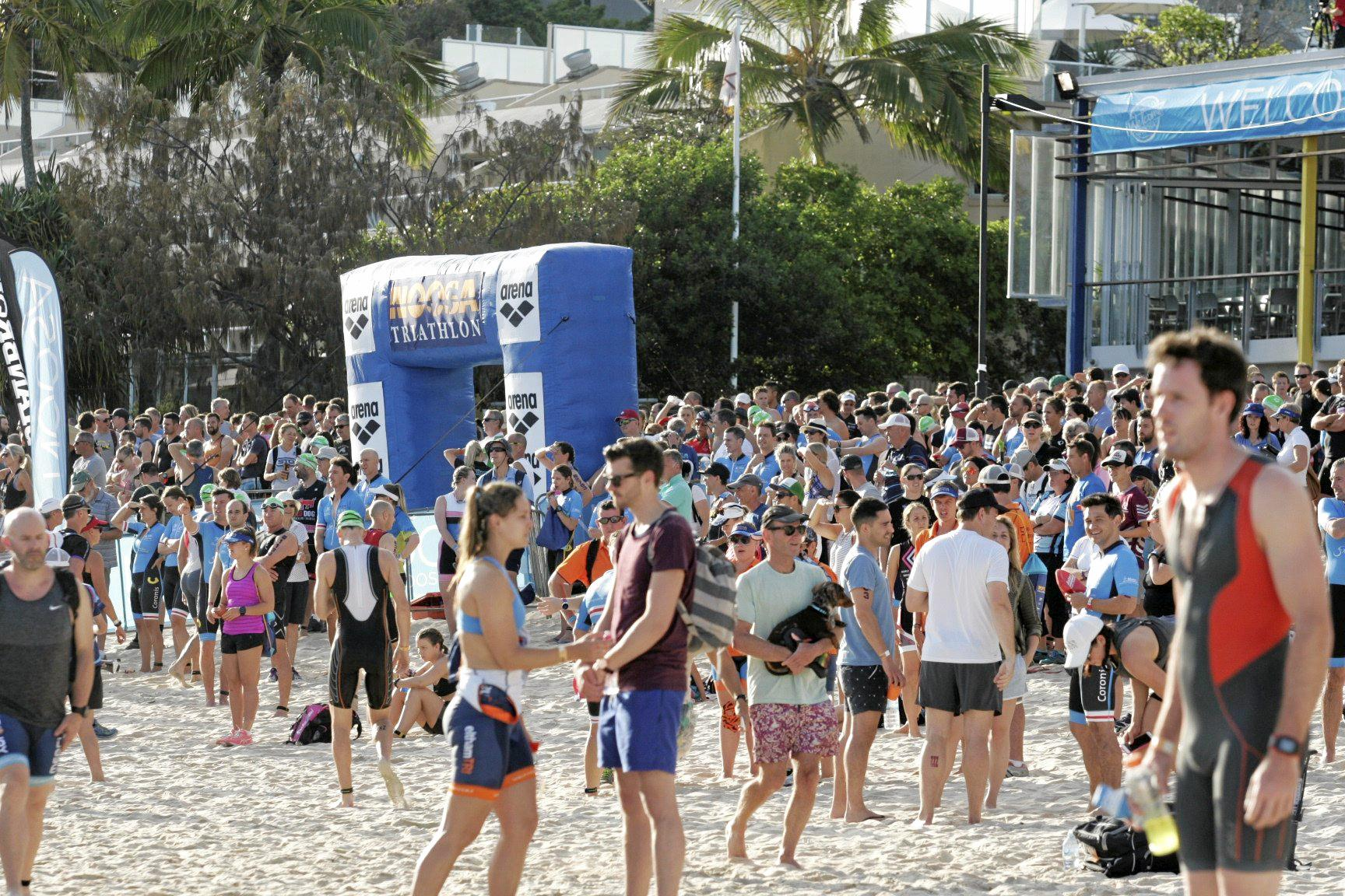 Spectators and athletes enjoy the 2016 Noosa Triathlon.Overview of start of swim leg at Main Beach Noosa.