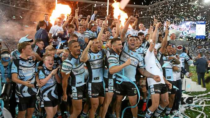 Cronulla players celebrate their 2016 NRL grand final triumph.