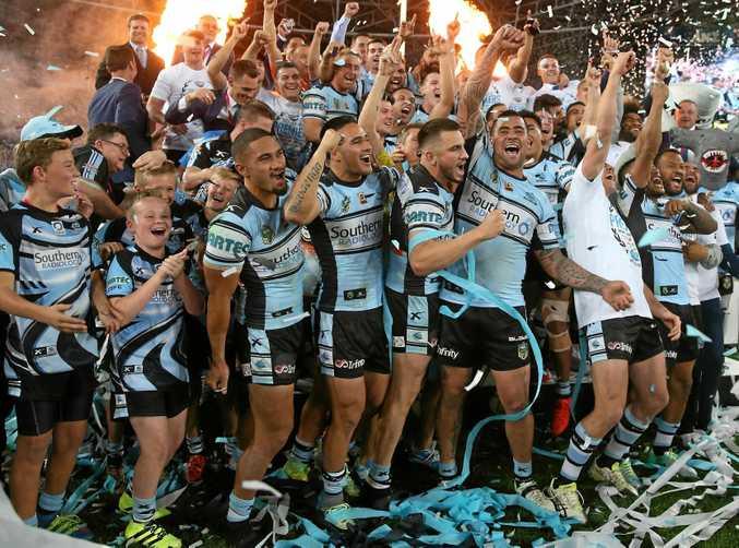 Cronulla players celebrate their 2016 NRL grand final triumph.