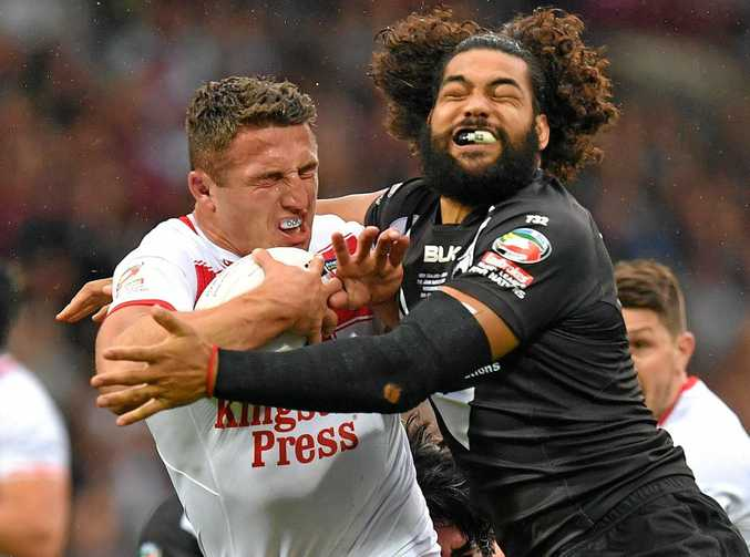 England's Sam Burgess is tackled by New Zealand's Adam Blair during their Four Nations match at the John Smith's Stadium in Huddersfield.