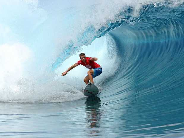 STAR: Julian Wilson posts a perfect ten point ride at the Billabong Pro Tahiti in August.