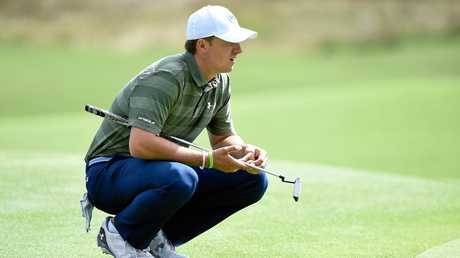 American Jordan Spieth lines up a putt on the 3rd hole