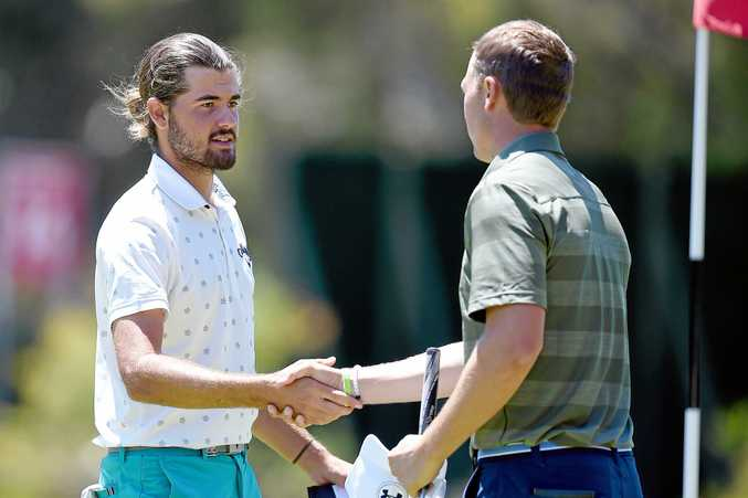 Australia's Curtis Luck, (left), shakes hands with American Jordan Spieth at the completion of their round 1 of the Australian Open