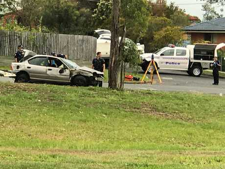 TRAGIC: Police at the scene of a fatal crash at Goodna on the corner of Albert St and Audrey St where a 26-year-old Redbank Plains man has died.