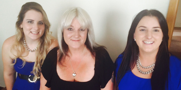 Zara and Lana Schofield with their mother Katrina Drummond.