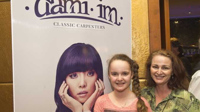 Kyra Bartlett-Horne (left) and Megan Bartlett-Horne (whose mother Irene Bartlett taught Dami singing at the Queensland Conservatorium) at Dami Im's Yesterday Once More: Classic Carpenters concert at the Empire Theatre.