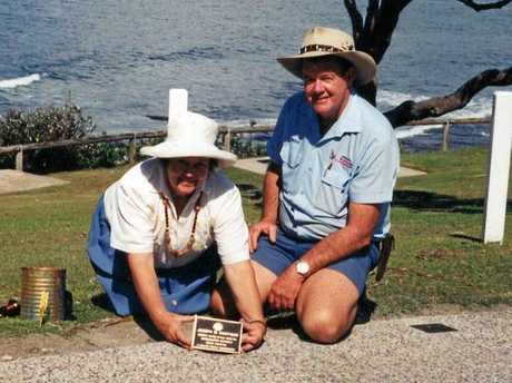 Erica and Bryan Costigan lay the plaque in memory of Joseph Costigan on the War Memorial Walkway at Caloundra.