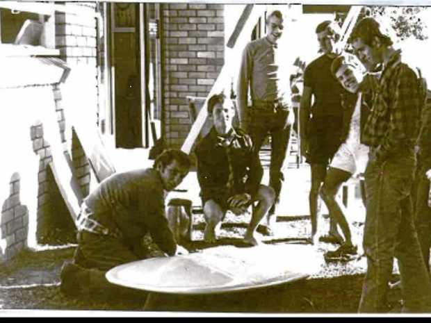 LONG-TERM TIES: Stephen Gregg, left, pictured by Gary Clist in 1968 with a new San Juan pintail surfboard with mates outside the Noosa Wave kiosk at the national park.