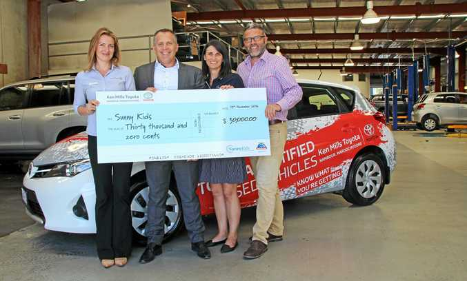 COMMUNITY DEDICATION: Kimberley Rider and Brett Mills  of Ken Mills Toyota present  Rachael Witton and Chris Turner (right) of SunnyKids with a cheque for $30,000 as a result of this year's Donation Drive.