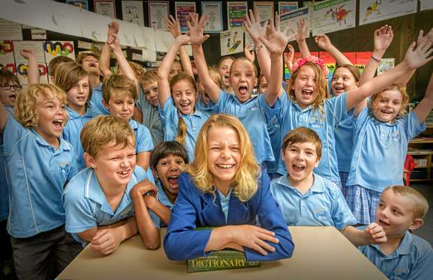 BUSY BEE: Yamba Public School student River Robinson gets a cheer from his Year 3 classmates after placing fourth in the state in the junior section of the Premier's Spelling Bee finals in Sydney.