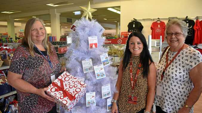 CHRISTMAS APPEAL: Annette Jasinski from Lifeline, with Target's Micarla Hobday and Rev Jenny Sims.