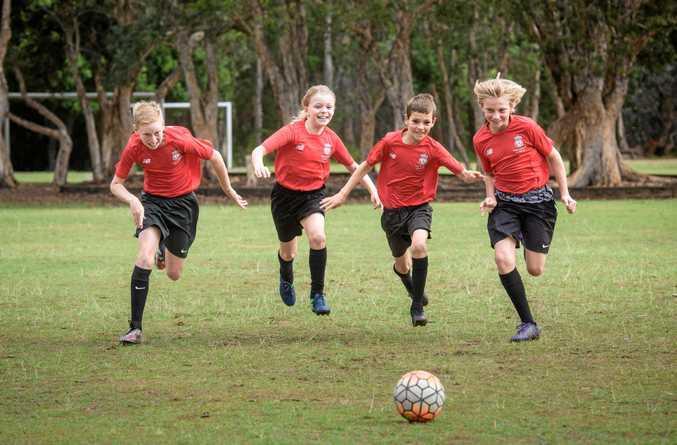 Yamba Public School students selected Liverpool FC training program Cameron Varcoe, 12, River Robinson, 9, Harley Walters, 10 and Connor Bridges, 12.