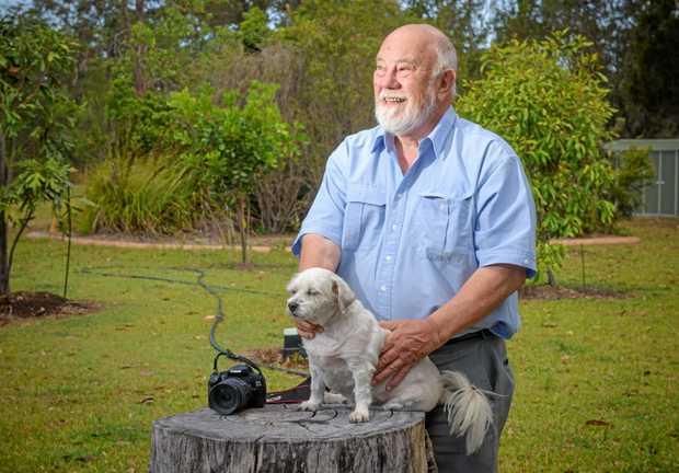 John Ibbotson of Gulmarrad with his dog looks over his backyard \