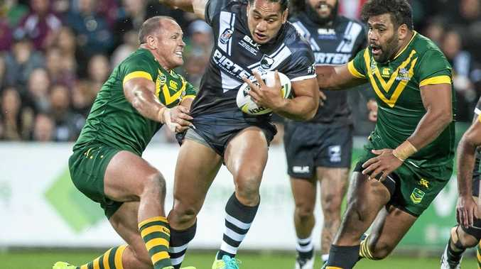 Martin Taupau of the Kiwis makes some hard yards against the Kangaroos.