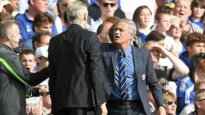 Former Chelsea manager Jose Mourinho (right), now with Manchester United, has an altercation with Arsenal manager Arsene Wenger in 2014.