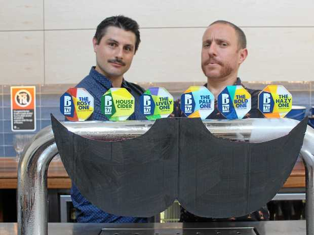 BROS WITH MO'S: William Brennan and Adam Keane from the Byron Bay Brewery are oiling and combing their moustaches and getting ready for a big fundraising event on Saturday, November 26.