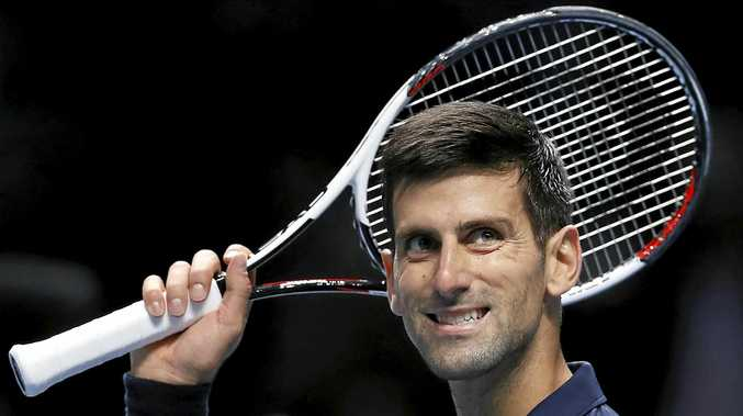 Novak Djokovic of Serbia celebrates winning match point against David Goffin of Belgium during their ATP World Tour Finals singles tennis match at the O2 Arena in London.