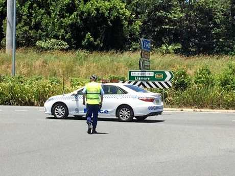 Police head to a crash at Alstonville believed to be between a truck and a motorcycle.