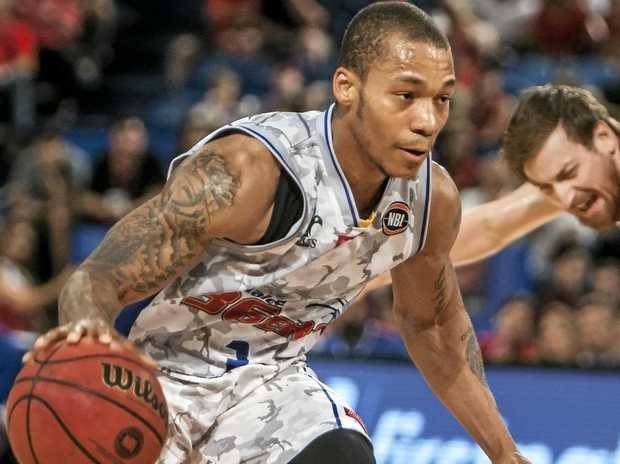 Adelaide 36ers star Jerome Randle looks for an opening against the Perth Wildcats.