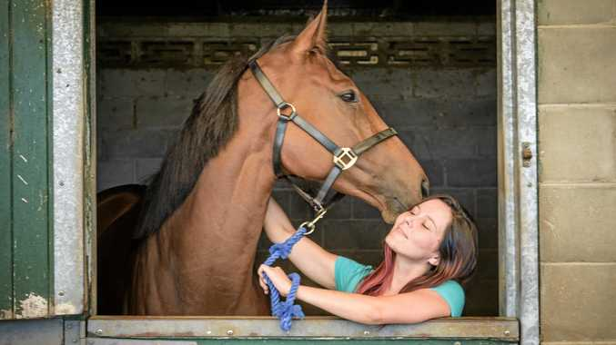Olivia Pickering gets a kiss from Consolari, who is runningn at Grafton on Sunday.