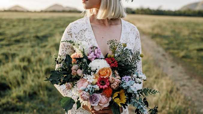 FLORAL FEVER: A floral arrangement held by model Erin Hartwell was created by Jess Mauger