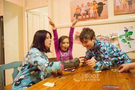 BOARD GAME FUN: Grace, Molly and Joshua Devereaux.