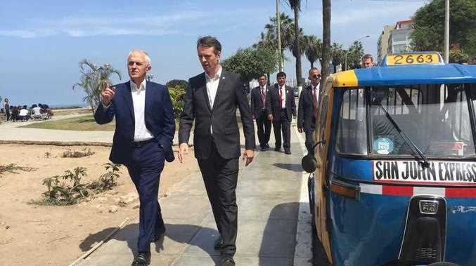 Prime Minister Malcolm Turnbull (L) takes a stroll along Malecon Barranco cliff top in Lima with Australian ambassador Nick McCaffrey, after arriving for the APEC leaders summit, Friday, Nov 18, 2016.
