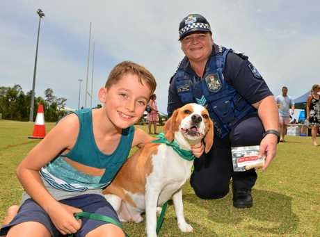 Ethan Jansen and his dog Wilson with Sergeant Yvette Tarrier at Peregian Springs for the launch of the police program, Dogs on Patrol aimed at encouraging the public to report crime.