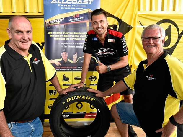 All Coast Tyre Solutions owners Peter (left) and John O'Leary (right) celebrate with V8 Supercar driver Fabian Coulthard to mark 20 years in business at Yandina.