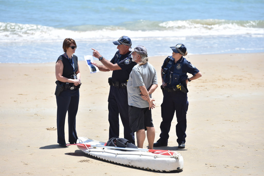 Super boat protest at Scarness Beach - Lee Carter talks with police before being arrested.
