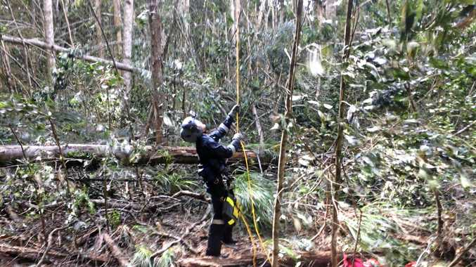 A supplied image obtained from facebook on Saturday, Nov. 18, 2016 of Queensland police ground crew being winched into bushland during a search, Mount Carbine, Queensland. A man's body has been found in the wreckage of a helicopter which crashed yesterday in the Daintree Rainforest, far north Queensland. (AAP Image/Rescue 510 Cairns)