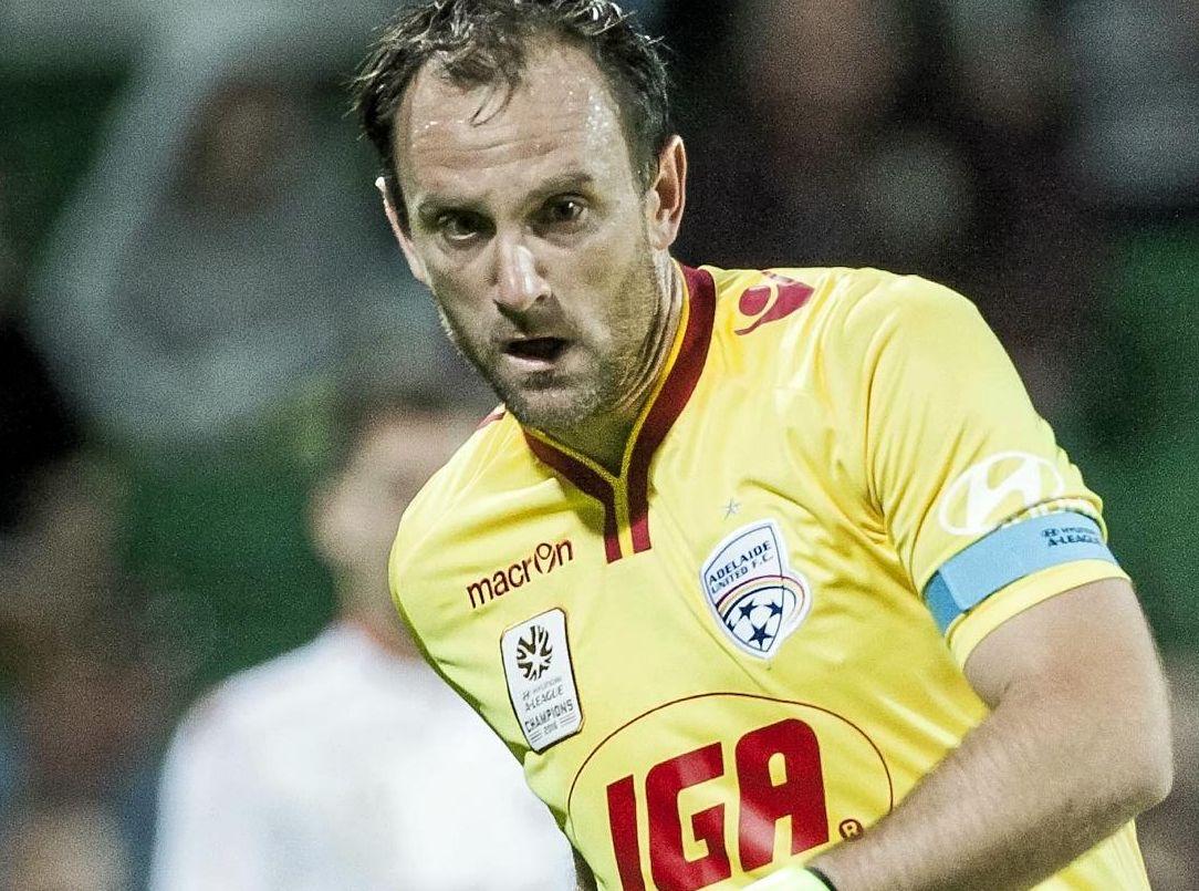 Adelaide United goalkeeper Eugene Galekovic clears the ball against the Perth Glory.