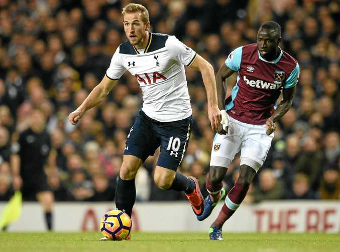 Tottenham Hotspur's Harry Kane sprints away from West Ham's Cheikhou Kouyate at White Hart Lane.