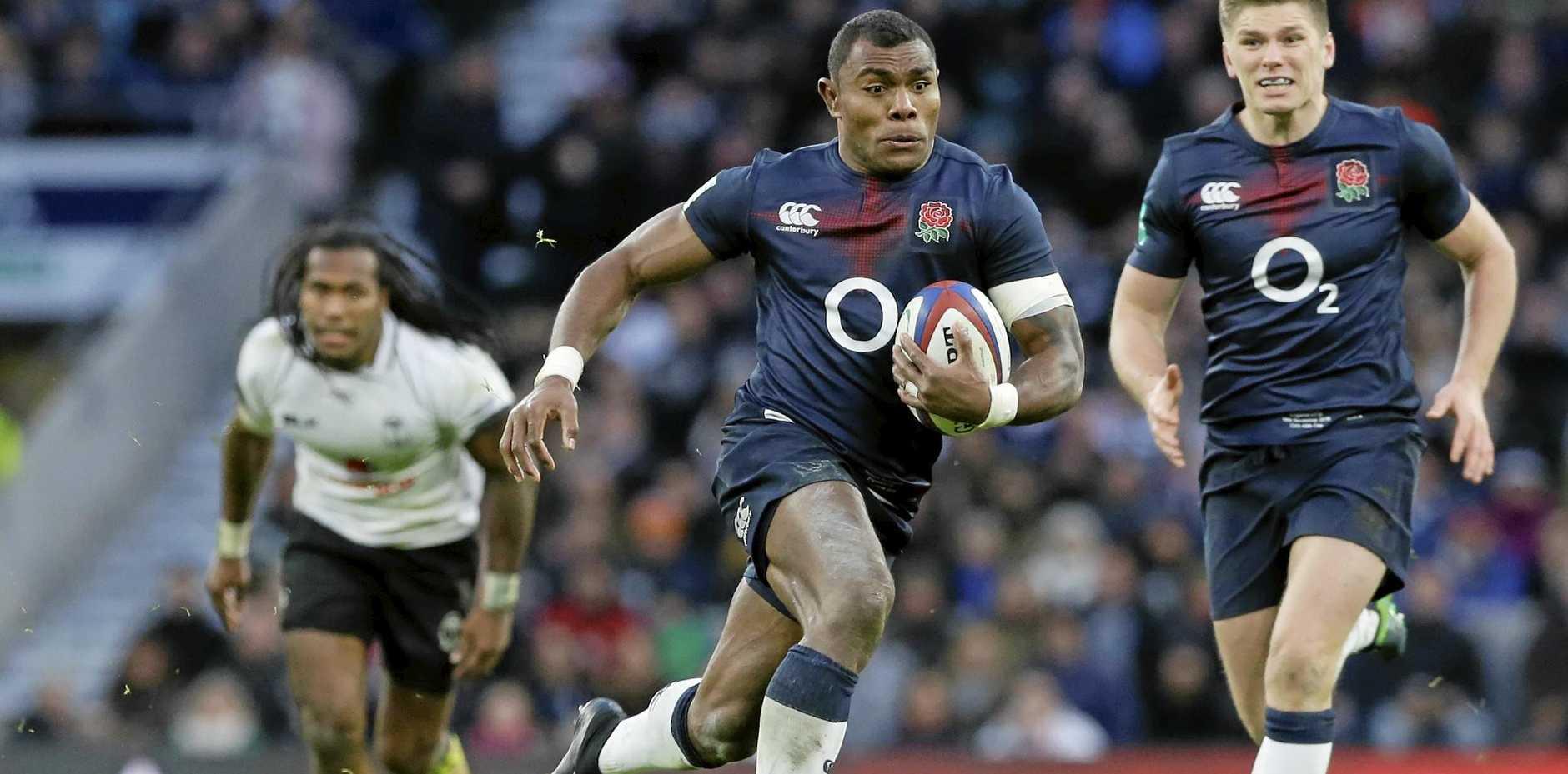 England's Semesa Rokoduguni gets away from the Fijian defence at Twickenham.