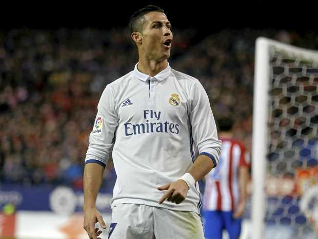 Real Madrid's Cristiano Ronaldo celebrates after scoring his side's third goal against Atletico Madrid.