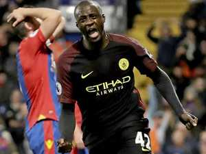 Toure repays Guardiola with a double as City go top