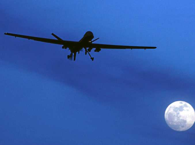 In this 2010 file photo, an unmanned US Predator drone flies over Kandahar Air Field, southern Afghanistan.