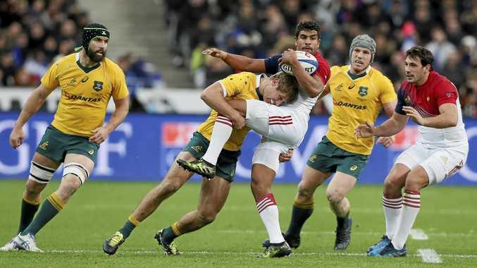 Australia's Kyle Godwin tackles France's Wesley Fofana.